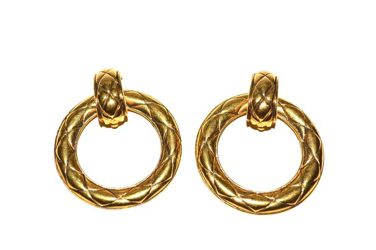 Gilt 1990s oversized door knocker style Chanel earrings with dual functionality. Signed. About 2.5