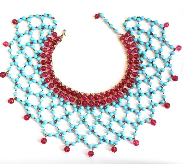 Beautiful turquoise blue and berry red Gripoix for Chanel necklace. Signed France on the hook. Confirmed to be earlier Gripoix by that maker. Dating to the beginning of the 1950s, before pieces were signed by Chanel. It is possibly an earlier piece