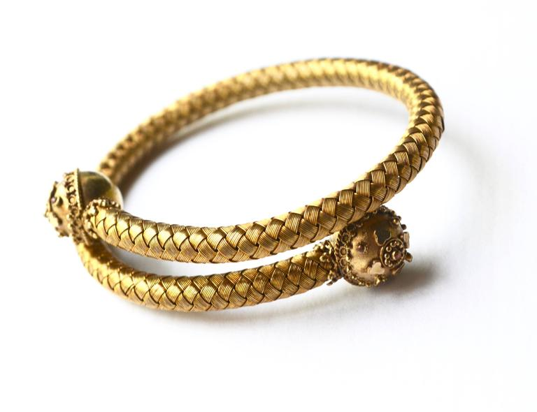 """Lovely woven 1800s wrap bracelet made of 14k gold. Condition is excellent.  Will adjust from about a 6.5"""" to 7"""" wrist or a bit more."""
