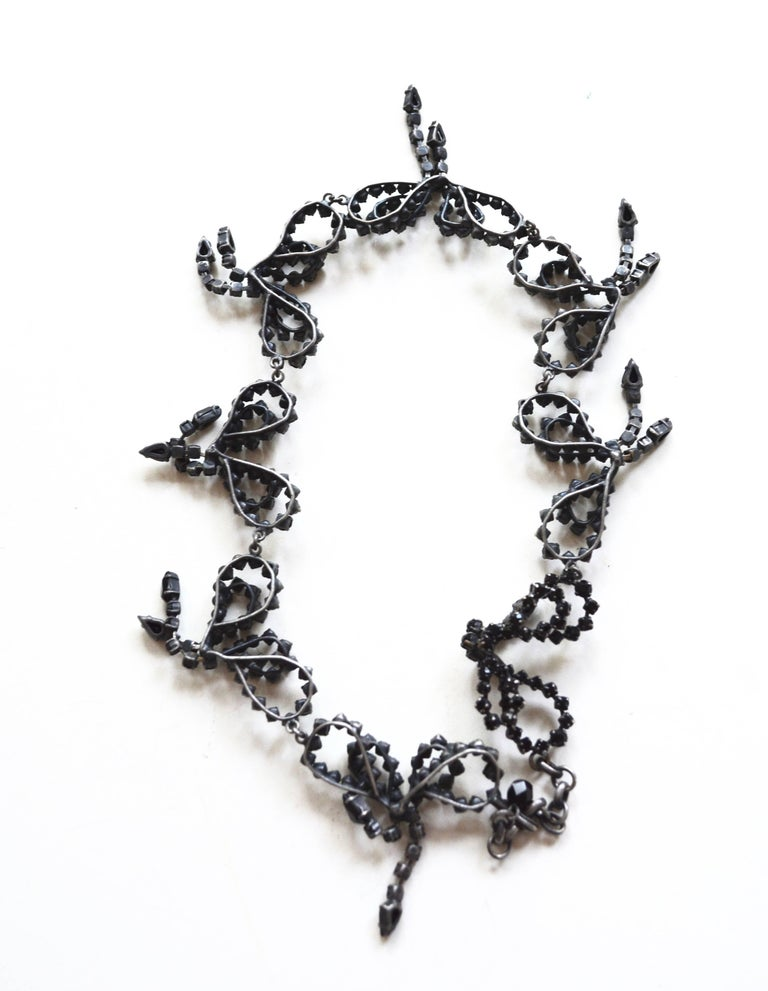 1960s black rhinestone handmade bow necklace. French in style. It has aspects similar to Roger Jean Pierre or Jean Scherrer for Dior. Not signed. Regardless of the brand it has a chic and great look on the neck.  The handmade aspect of the bows