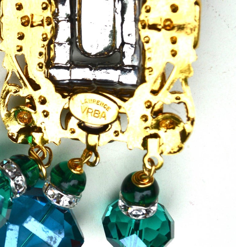 Glass Emerald and gilt metal filigree earrings in an oversized style. Handmade with lots of detail, signed. One bottom stone is set a bit off due to hand made aspects. 4.5