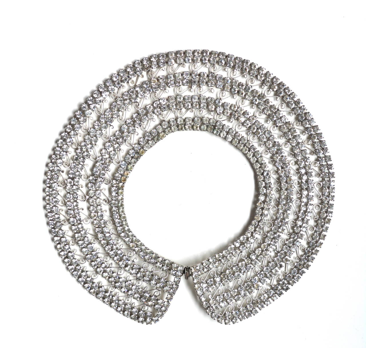 1950s rhinestone collar, unsigned, but has a bit of that Juliana style scroll metal detailing. However, I believe it is unsigned Hattie Carnegie as I have seen a signed similar necklace.  This piece can be worn in the traditional choker style or