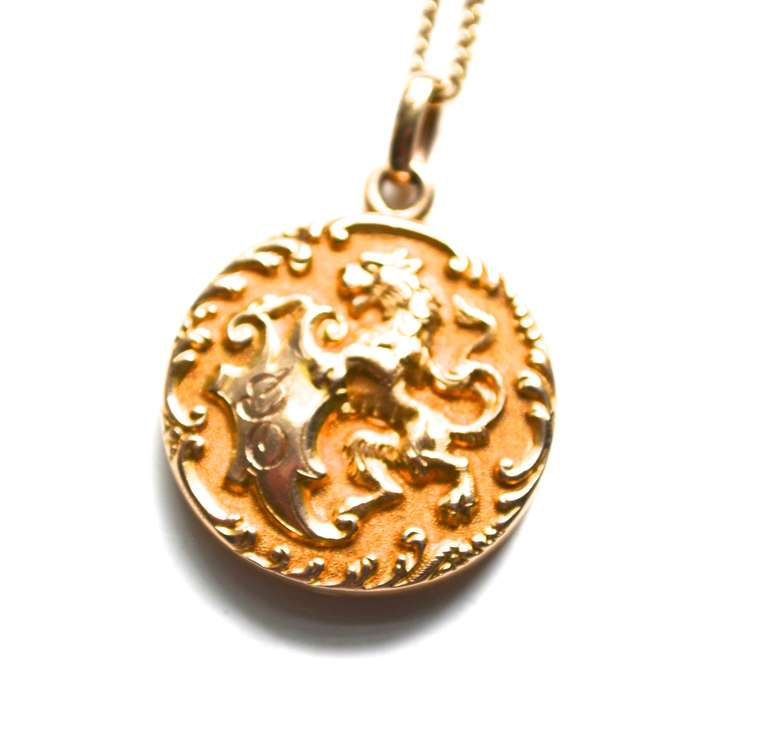 Late 1800s early 1900s 14K gold chain and 14k and rolled gold locket. The inside has the mark R14K. Has been tested by a jeweler and the outside seems to be 14k with rolled gold elements inside.  It's appearance is stunning and it looks solid. The