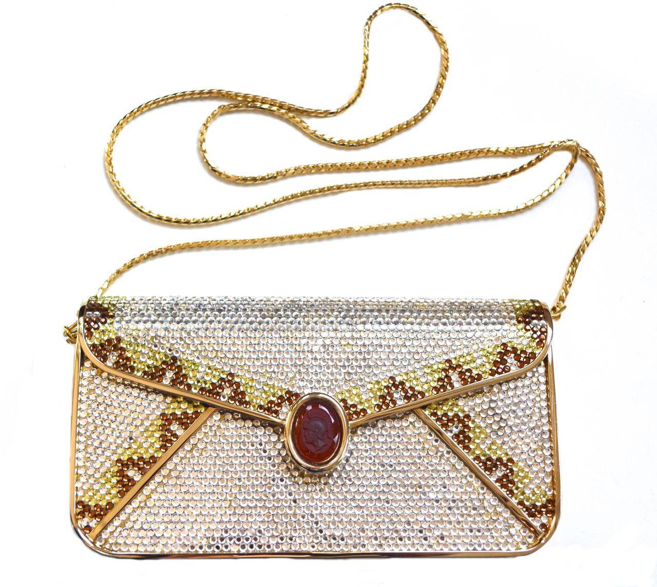 Circa 1970s glam Swarovski crystal and carnelian intaglio clutch with snake chain adjustable strap.  Signed inside. Gold lining is clean. Amazing red carpet or party bag option.  Unique detailing and quality construction.  Measures 7″ long X 4″
