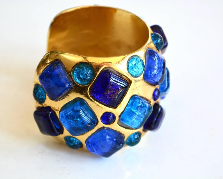 Handmade French designer Gripoix cuff signed Dominique Aurientis. The bracelet appears to be molded and is irregular in some original aspects ( there are some a linear marks in the finish, due to the way it was made.  The colors are rich and the