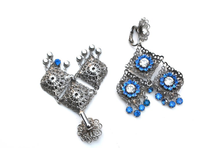 "Vintage unsigned silver metal and blue rhinestone earrings, circa 1960s. Great movement and scale.  About 2.75"" long x 2"" wide."