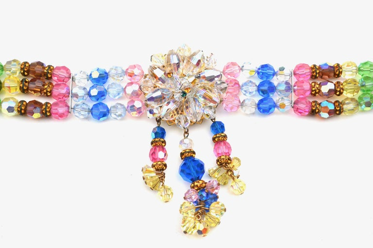 "Vibrant crystal bead choker circa 1950s. Slightly adjustable. Unsigned. Features a few beads with an aurora borealis finish. Max of about 15.5"", but meant to be a choker, min 13.5"". Very good some were to metal aspects aging, tarnish."