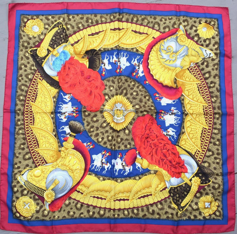 "Gorgeous royal themed deep vibrant colored Casques Plumies silk scarf. Original silk screen design c1989 by Julia Abadie. This is vintage.  Hand rolled edges. 35"" X 35"". Excellent. Rare piece. Arrived just in time for a royal wedding!"