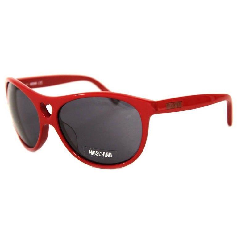 b7406610ab Moschino sunglasses in red acetate with heart-shaped hole. Good conditions.  Please note