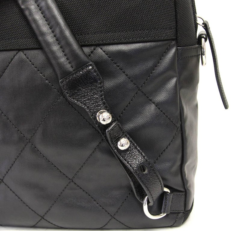 Women's or Men's 2000s Chanel Black Leather and Nylon Backpack For Sale