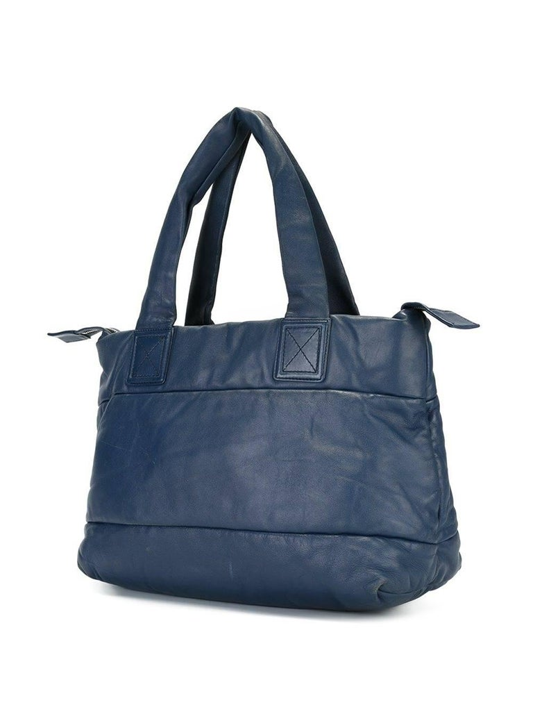 45d63cdf3a703f Chanel blue leather branded panelled tote bag. It features round top  handles, an embossed