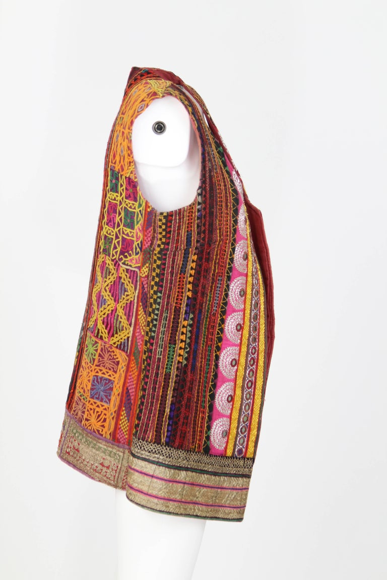 1980s Colorful Ethnic Gilet carfelly handmade and embroidered, made of original ethnic cloths from Rajasthan, a region of India.  Small mirrors are sewn all over the item giving it a special allure. The item presents signs of use but it is overall
