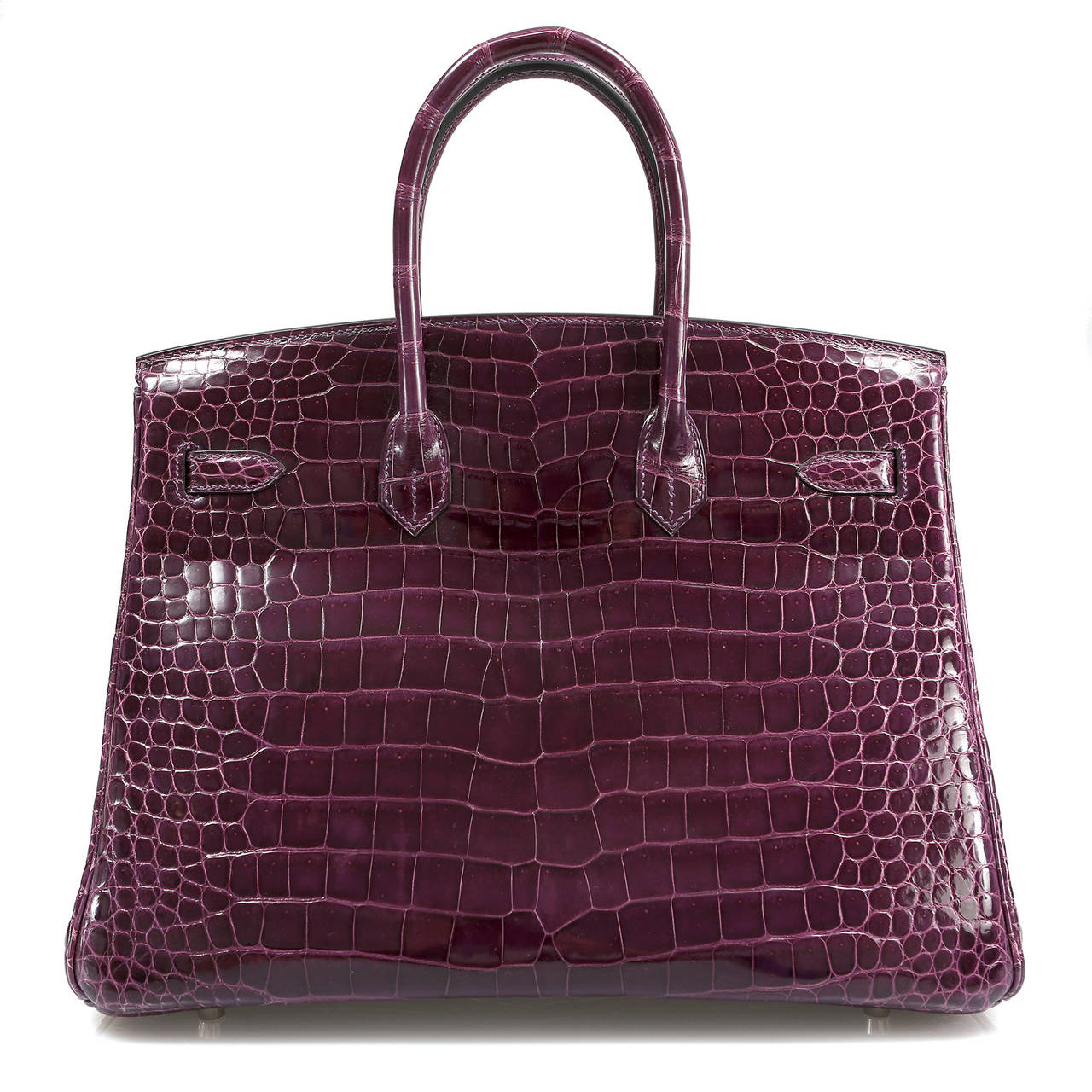 Hermès Cassis Shiny Porosus Crocodile 35cm Birkin has never been carried and remains totally pristine.  Incredibly rare and specially ordered, this exotic Birkin is truly stunning in jewel toned purple croc with Palladium hardware. 