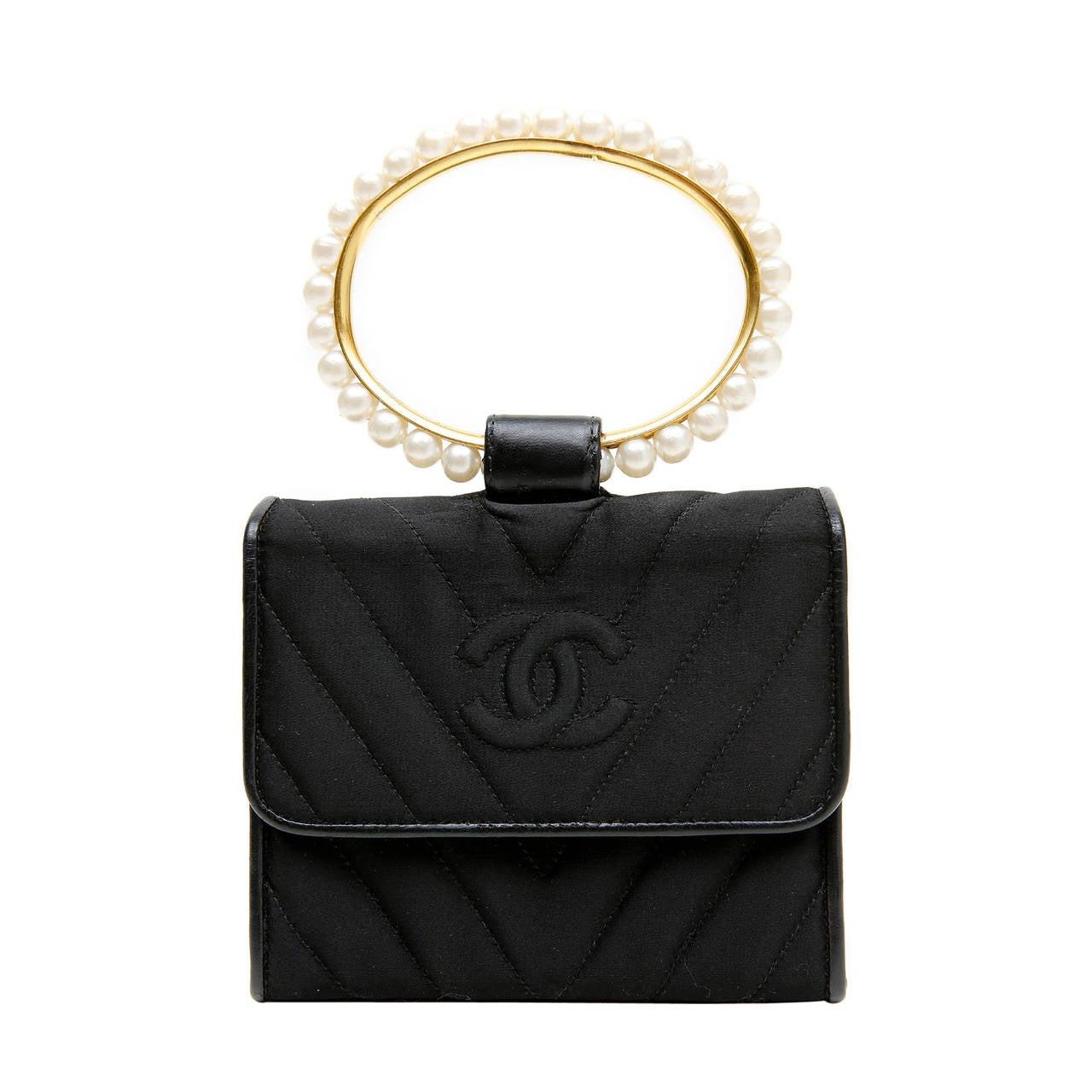 chanel black pearl handle vintage evening bag at 1stdibs