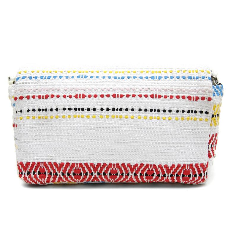 Chanel White Multicolor Woven Flap Bag - EXCELLENT PLUS  Uniquely patterned in a soft tribal print with happy colors, this charming Chanel is a must have on any holiday or summer getaway.   White woven fabric is striped in shades of bright blue,