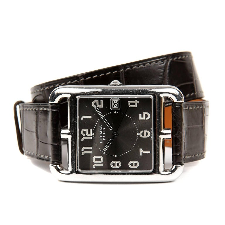 Hermès Cape Cod Watch is in excellent plus condition.  Silver square case inside rectangle.  Chain d'ancre style numerals with date.  Grey croc double tour band.