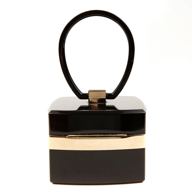 """Chanel Black Lucite and Gold Devil Wears Prada Bag- PRISTINE   From the 2004 collection, this exquisite collectible was featured in the movie titled, """"Devil Wears Prada.""""  Black Lucite square box style bag is accented with metallic gold.  CC clasp"""