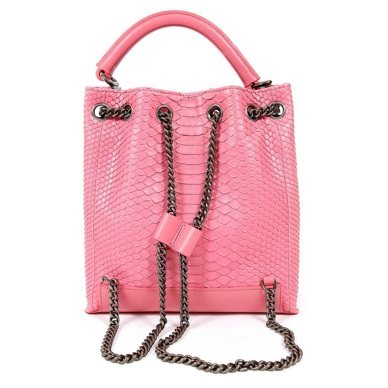 Chanel Pink Python Backpack- Pristine, NEVER CARRIED.  A fabulous exotic that stands out in a sea of black, the pop of pink is superbly amplified by the texture of the python.   Bubblegum pink python skin traditional backpack has edgy ruthenium