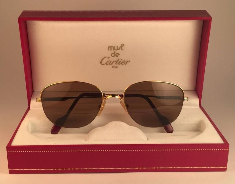 New 1983 Cartier Montaigne Vendome sunglasses with brown (uv protection) lenses. Frame is with the front and sides in yellow and white gold. All hallmarks. Cartier gold signs on the earpaddles. These are like a pair of jewels on your nose with the