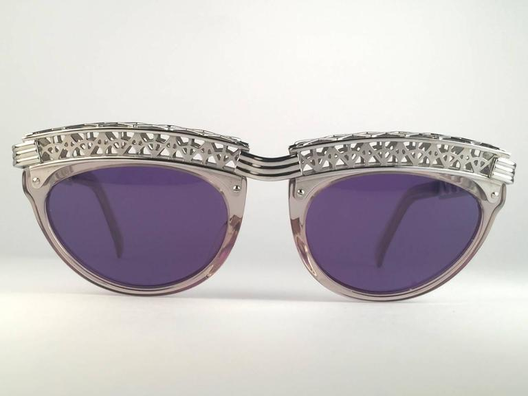 Superb Collectors Item!! New Jean Paul Gaultier 56 0271 Eiffel Tower clear frame.  Spotless dark purple lenses that complete a ready to wear JPG look.  Amazing design with strong yet intricate details. Design and produced in the 1900's. New, never