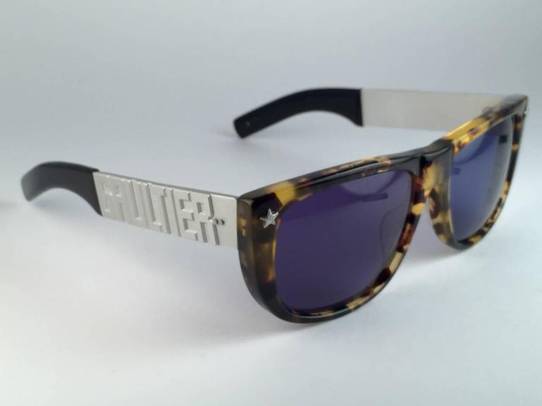 New Collectors Item!!  New Iconic Jean Paul Gaultier 56 8272 Tortoise Silver Matte temples frame.  Dark blue lenses that complete a ready to wear JPG look. The very same model worn by Vanilla Ice in 1990's. Amazing design with strong yet intricate