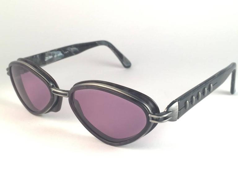 New Jean Paul Gaultier 56 0015 Marbled Grey matte frame with ornamental bullet like details.  Spotless smoke grey lenses that complete a ready to wear JPG look.  Amazing design with strong yet intricate details. Design and produced in the
