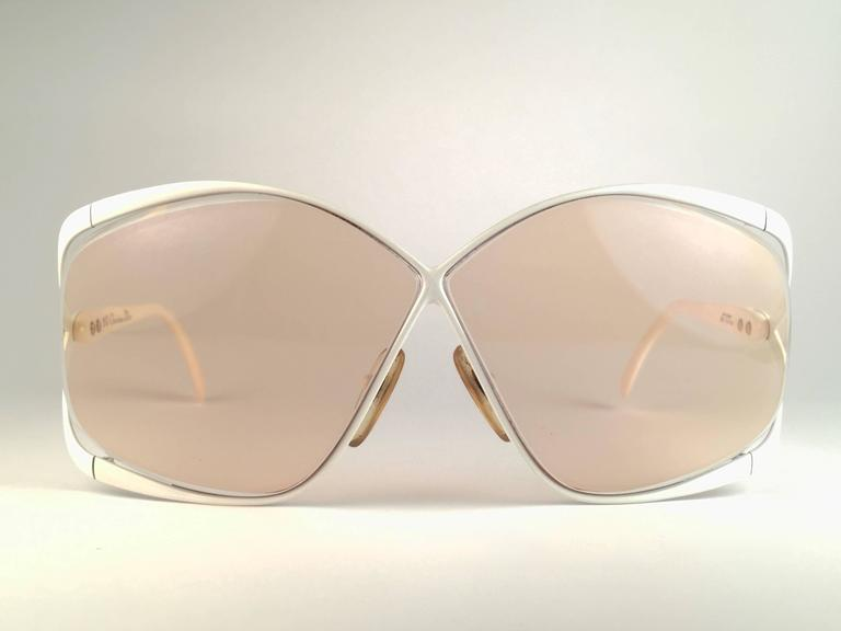 Highly coveted Christian Dior butterly shape in white and beige.  Spotless light brown lenses. A collector's piece!   Come with its original Christian Dior lunettes sleeve. This pair has minor sign of wear due to storage. New, never worn or