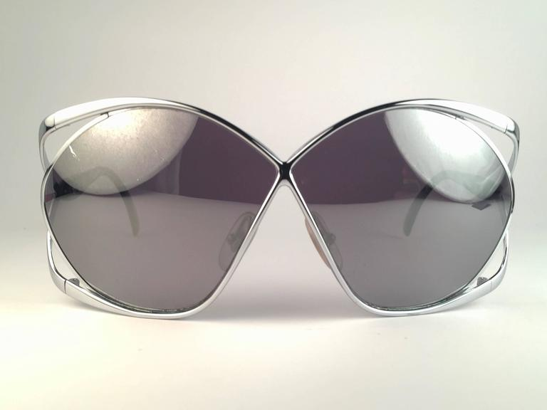 e9ea6eb777d9b Highly coveted Christian Dior butterly shape in sleek silver. Spotless  silver mirror lenses. A