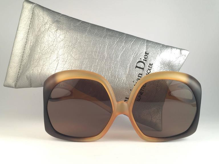New Vintage Christian Dior 2005 Matte amber ombre frame sporting spotless solid brown lenses.   Made in Germany.   Produced and design in 1970's.  New, never worn or displayed. Comes with its original silver Christian Dior Lunettes sleeve.