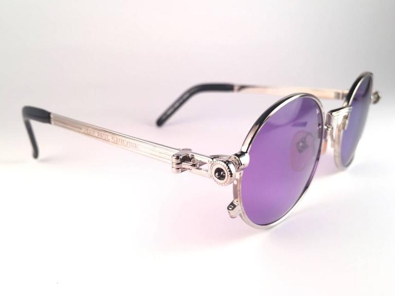 New Jean Paul Gaultier 56 4178 round silver metal frame.  Flat dark purple lenses that complete a ready to wear JPG look.  Amazing design with strong yet intricate details. Design and produced in the 1990's. New, never worn or displayed. A true