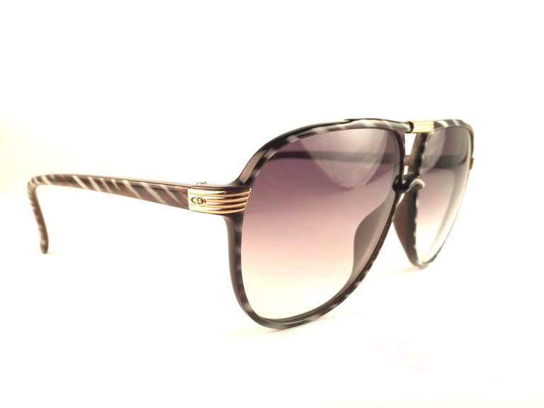 New Vintage Christian Dior 2300 90 Sunglasses zebra stripes frame with spotless rose gradient lenses.  1970's Made by Optyl.   Manufactured in Germany   New! never worn or displayed.   Flawless pair!!!