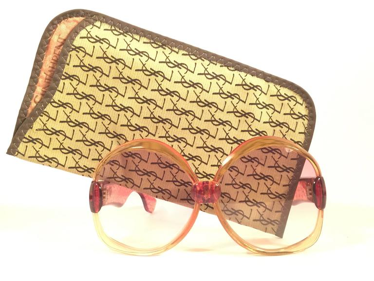Beautiful and stylish vintage new Yves Saint Laurent 1970's Oversized sunglasses in a translucent light amber frame with jasper temples. Spotless pair of light rose gradient lenses. New! never worn or displayed. Flawless pair!!!   Comes with its