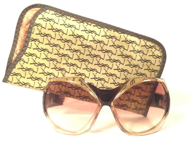 Beautiful and stylish vintage new Yves Saint Laurent 1970's Oversized  sunglasses in a translucent mask shaped frame. Spotless pair of light amber gradient lenses. New! never worn or displayed. This pair has minor sign of wear due to