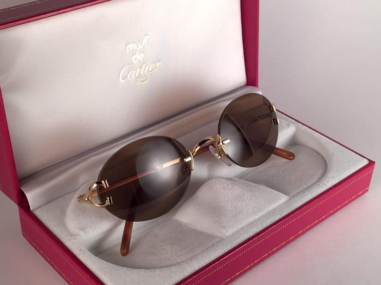 0951ee06ea23 ... 45mm Gold Rimless Brown Lens Case France Sunglasses For Sale. New 1990 Cartier  Scala unique rimless sunglasses with brown (uv protection) lenses. Frame
