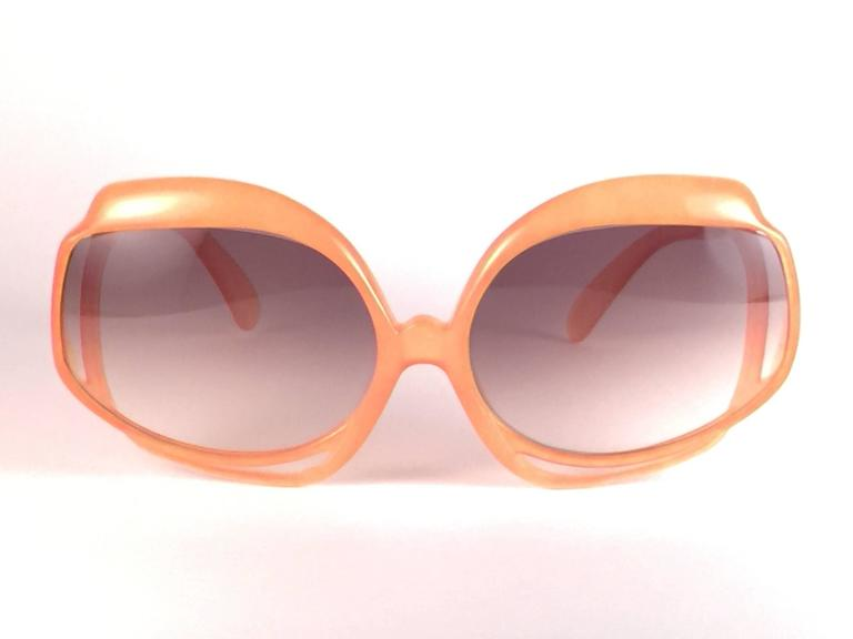 New Vintage Christian Dior 2026 30 tangerine frame with spotless light brown gradient lenses.   Made in Germany.  Produced and design in 1970's.  A collector's piece!  New, never worn or displayed. Comes with its original silver Christian Dior