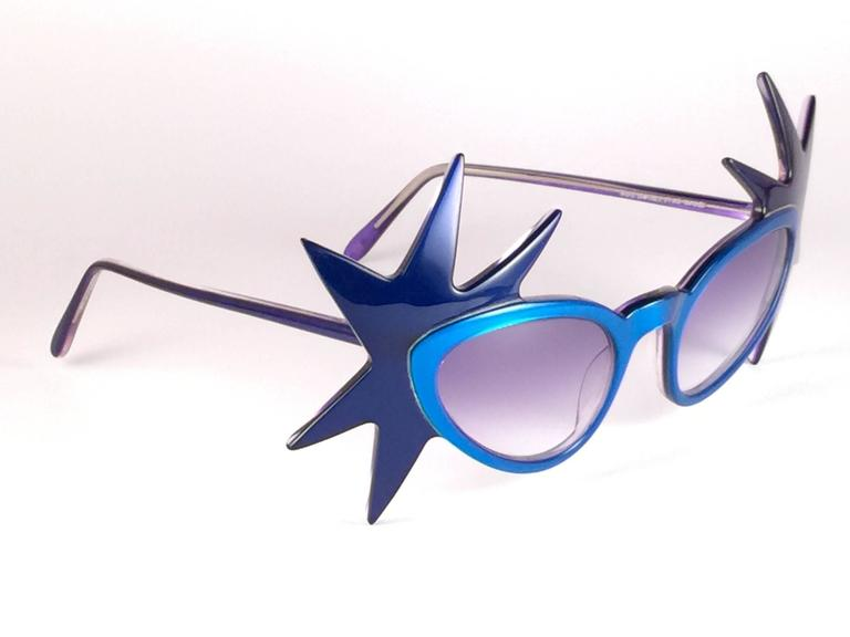 """Highly collectable """" Double Star """" sunglasses signed by English Anglo American Optical. Two tone blue frame holding a spotless pair of blue gradient lenses.  New, never worn or displayed. This pair is a true fashion statement. Made in England."""