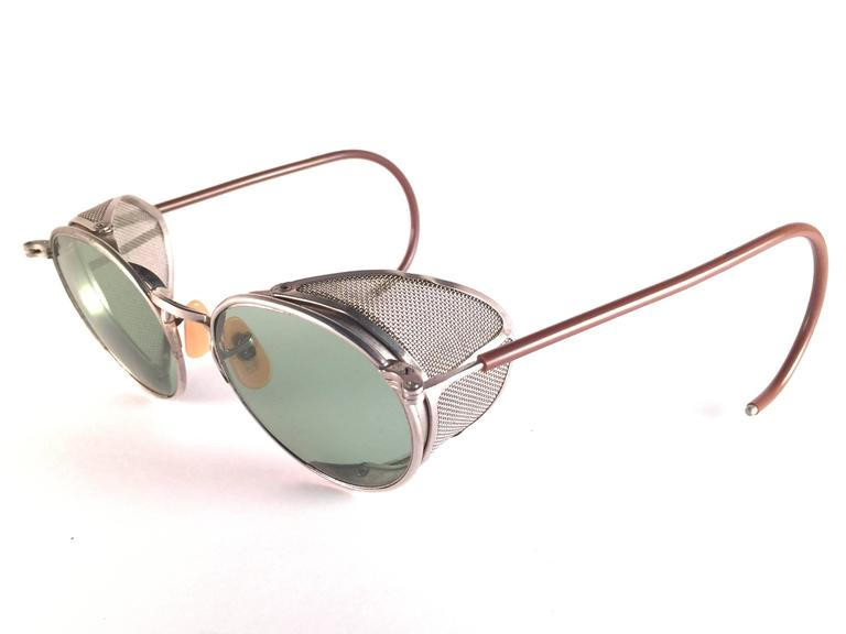 Superb Item!  1950's Bausch & Lomb Safety Goggles.  Folding silver metal side cups and special wrapped temples.  Mint true green round lenses with light wear on them. Please note that this item is nearly 70 years old and has some ageing patina on