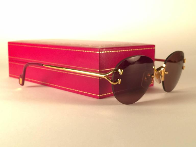 570ed9ea568b New Vintage Cartier Portofino Gold 50mm Rimless Brown Lens France Sunglasses  In New Condition For Sale