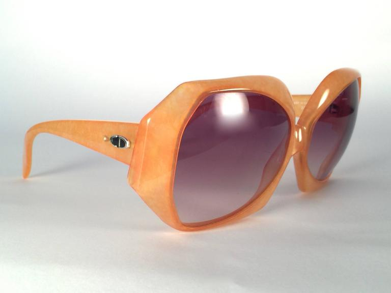 New Vintage Christian Dior 2025 30 Jasped Amber frame sporting light brown gradient lenses.    Made in Germany.   Produced and design in 1970's.   A collector's piece!   New, never worn or displayed. Comes with its original silver Christian Dior