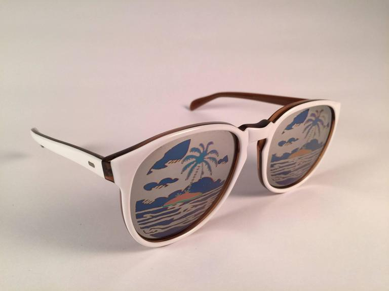 Super Rare Michele Lamy designer, muse and partner to Rick Owens, white sunglasses with mirror lenses with a colourful print. You almost don't see the print while wearing them.  New, never worn or displayed. This par may show minor sign of wear due