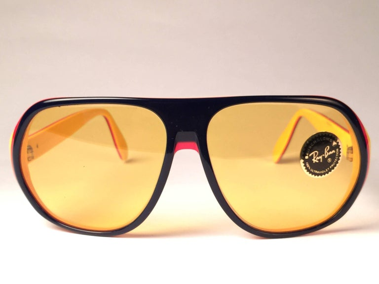 New and rare Vintage Blazer blue, red and yellow frame holding an Ambermatic mirror pair of lenses.   New, never worn or displayed.  This pair may have minor sign of wear due to nearly 40 years of storage. Designed and Produced in USA.