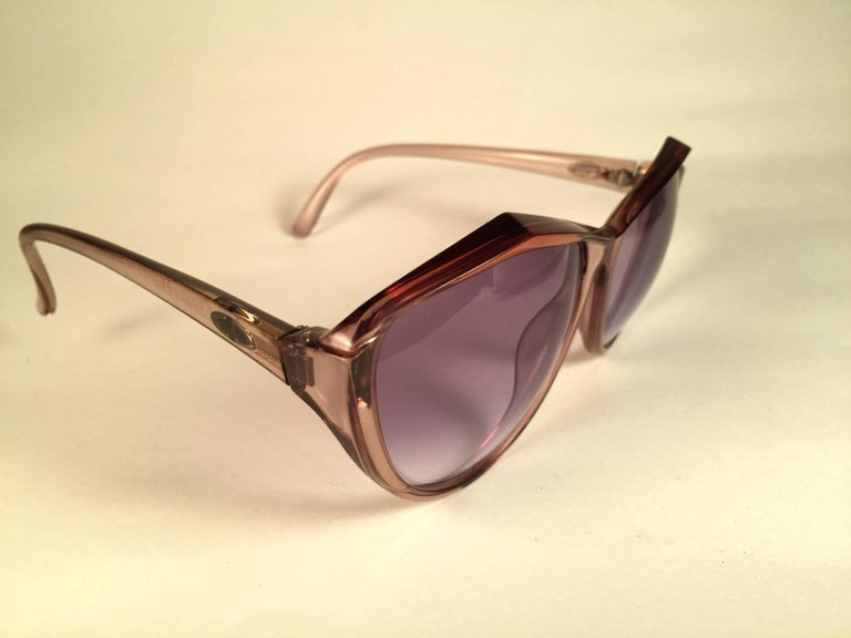 New Vintage Christian Dior 2234 Translucent frame sporting light purple gradient lenses.   Made in Germany.  Produced and design in 1970's.  A collector's piece!   New, never worn or displayed. Please notice this item is nearly 50 years old so it