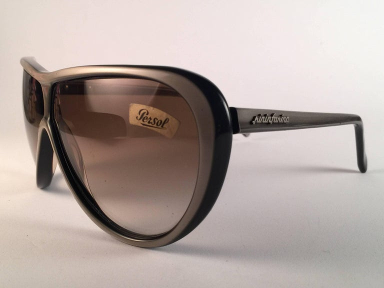 New Vintage Persol Ratti Pininfarina Sunglasses.   Spotless pair framing light grey lenses.  New, never worn or displayed. This pair may show minor sign of wear due to storage.    Made in Italy
