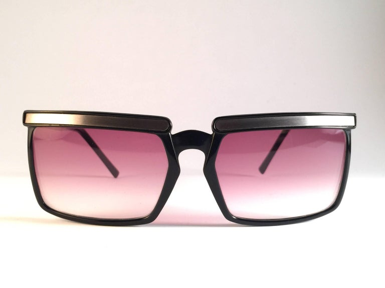 Beautiful and stylish vintage new Yves Saint Laurent 1980's   Oversized sunglasses in black with silver accents. Spotless pair of light rose gradient lenses. New! never worn or displayed. This pair may show minor sign of wear due to