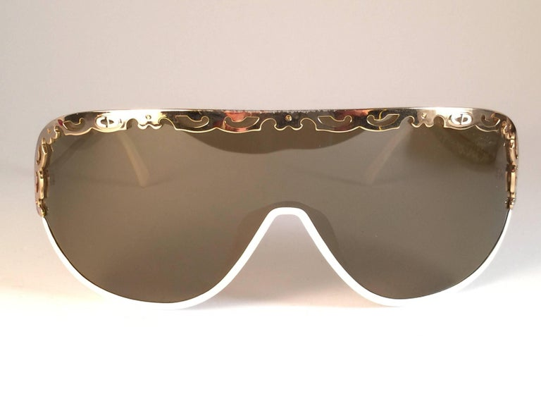 New Vintage Christian Dior 2501 white mask sunglasses wrap around style with solid brown lenses 1980's.  This item may show light sign of wear due to storage.  Made by Optyl. Manufactured in Austria