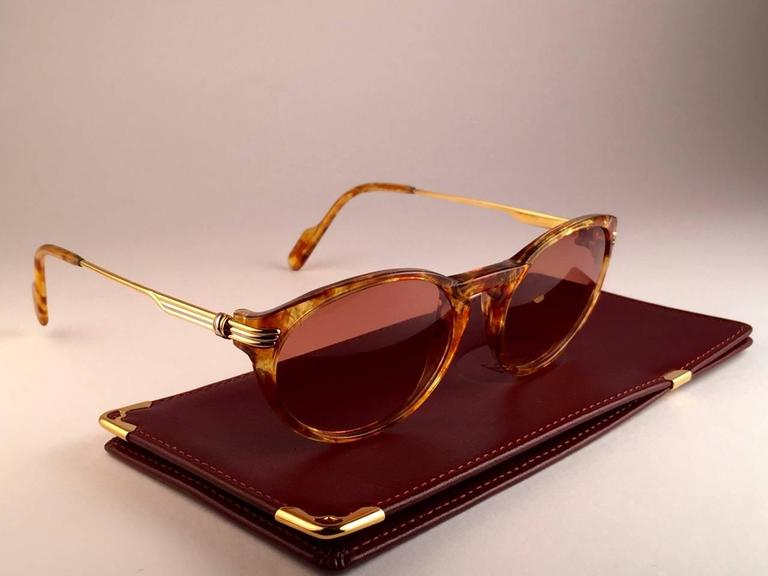 New Cartier Aurore Classic sunglasses with brown (uv protection) lenses. Small size 50mm/18 frame has the famous real gold and white gold accents on the temples. 100% original. All hallmarks. Cartier gold signs on the earpaddles. These are like a