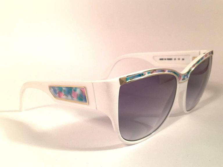 Rare pair of New vintage Leonard sunglasses.   White with signature colours mosaic with gold accents frame holding a pair of rose gradient lenses.  New, never worn or displayed. Made in France.