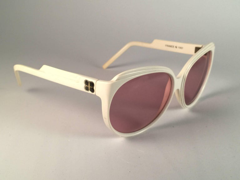 New Vintage Balenciaga White oversized frame holding a spotless pair of rose  lenses.  Never worn or displayed. This pair could show minor sign of wear due to storage.  Designed and produced in France.