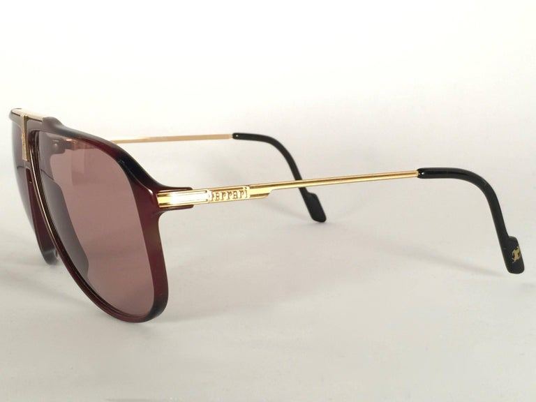 872e1049d6d Source · Mint Vintage Ferrari Bordeaux and Gold Accents 1980 Made in Italy