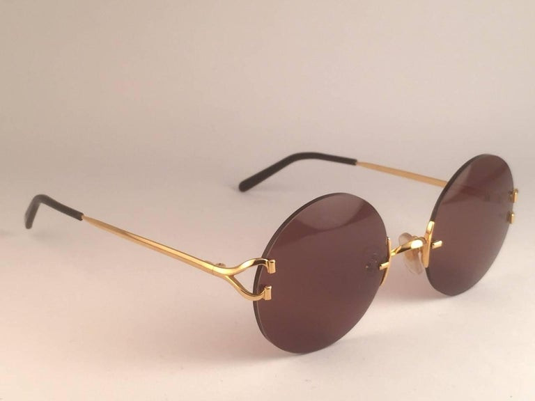 d8383d4147 Women s or Men s New Cartier Madison Round Rimless Gold 50mm Brown Lens  France Sunglasses For Sale